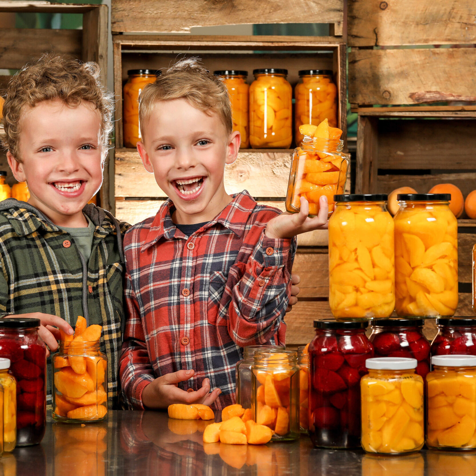 Fruit preserving season is now underway Rayner's Orchards is providing classes in how to preserve fruit. Twins, Hudson and Carter, 6.  Picture: Tim Carrafa